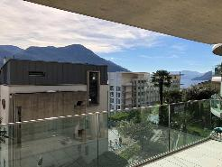 Moderno appartamento con terrazzi e vista lago a Brissago